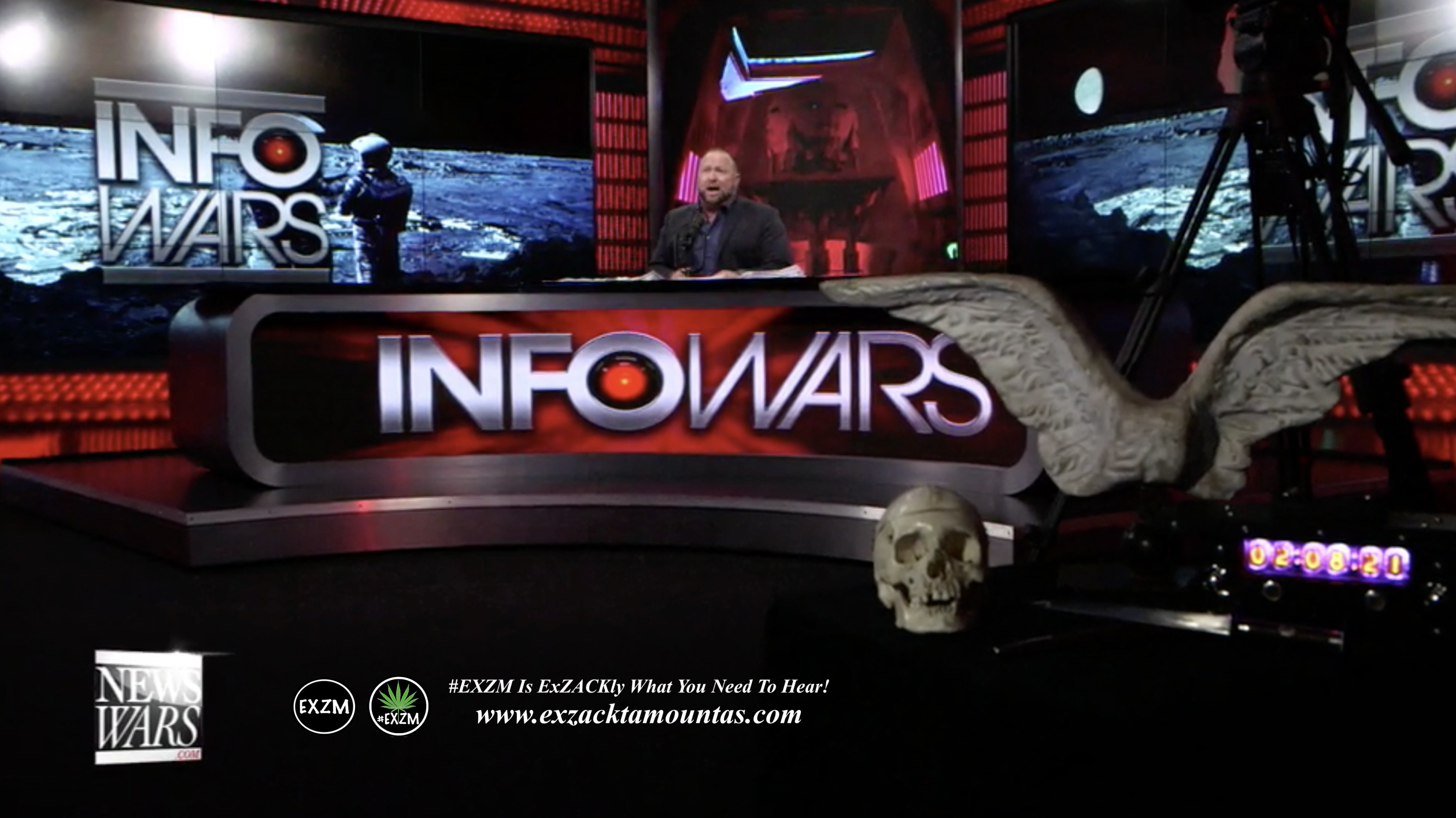 Alex Jones Infowars Studio Human Skull Angel Wings EXZM Zack Mount February 8th 2021 copy