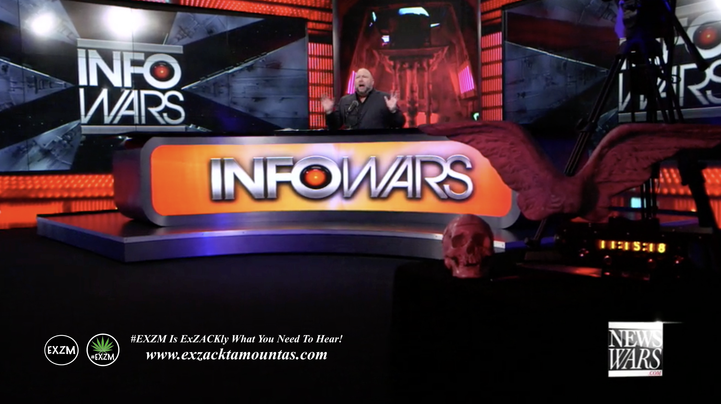 Alex Jones Live Infowars Studio Red Angel Wings Red Human Skull EXZM Zack Mount February 26th 2021 copy