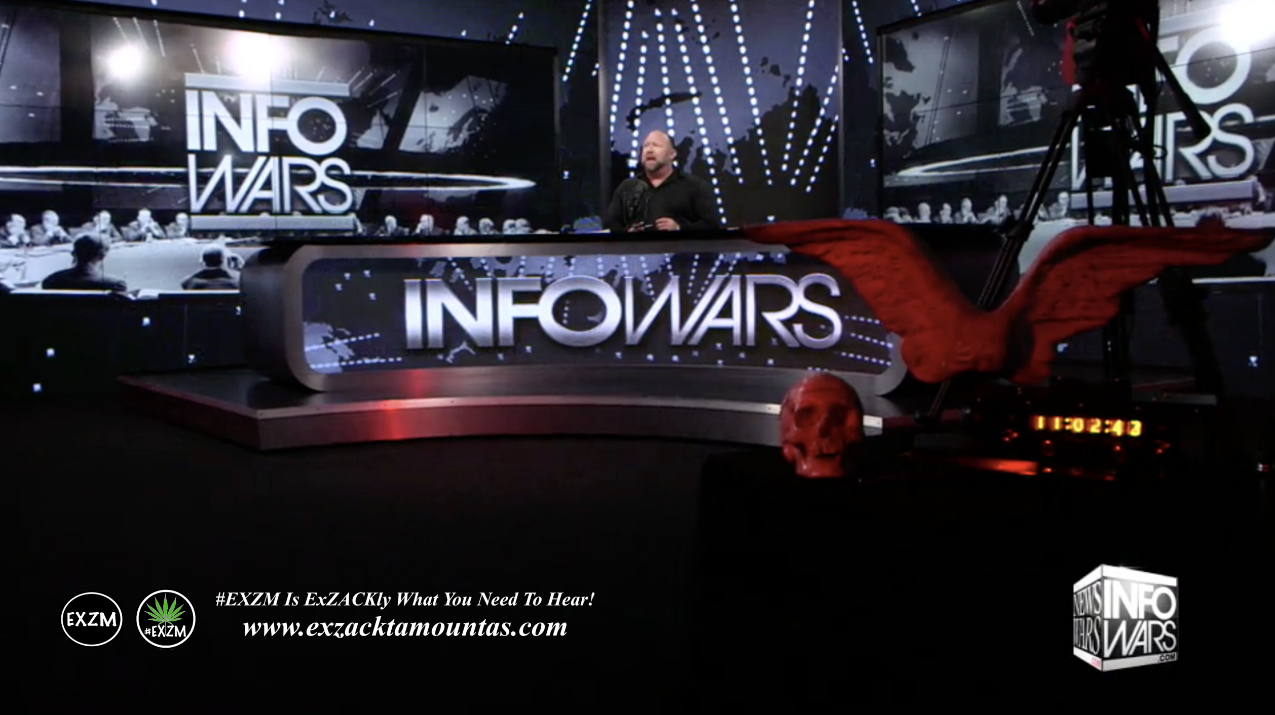 Alex Jones Live Infowars Studio Red Angel Wings Red Skull EXZM Zack Mount February 23rd 2021 copy
